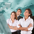 Stock Photo: Business team with a world map