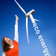 Woman with a windmill - Stock Photo