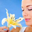 Woman smelling a flower — Stock Photo #7737274