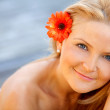 Beautiful woman with a flower — Stock Photo