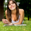 Stock Photo: Pensive woman studying