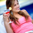 Woman with a cocktail - Stock Photo