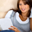 Beautiful woman reading - Stock Photo