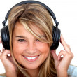 Woman with headphones - Stock Photo