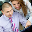 Business couple on a laptop — Stock Photo #7738754