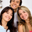 Man and two girls smiling — Stock Photo