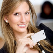 Woman with a business card — Stock Photo