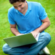 Man with a laptop outdoors — Stock Photo