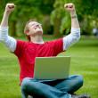 Excited man with laptop — Stock Photo
