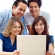 Stock Photo: Group of with a laptop