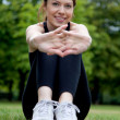 Stock Photo: Woman stretching outdoors