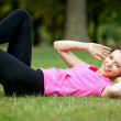 Woman doing abs — Stockfoto