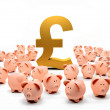 Golden pound symbol and piggybanks — Stock Photo