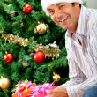 Man with Christmas gift — Stock Photo