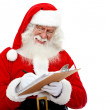 Santa writing a list — Stockfoto