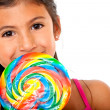 Girl eating candy — Stock Photo #7739342