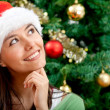 Royalty-Free Stock Photo: Pensive Christmas woman