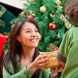 Christmas woman givin a present — Stock Photo