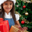 Girl with Christmas presents — Stock Photo #7739376