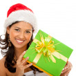Christmas woman with a gift — Stock Photo #7739388