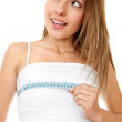 Woman measuring her breast — Stock Photo #7739512