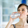 Stock Photo: Gym woman drinking water