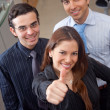 Executives with thumbs up — Stock Photo