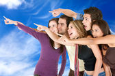 Friends pointing at the sky — Stock Photo