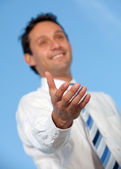 Business man stretching his hand — Stock Photo