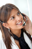 Business woman with a headset — Stock Photo