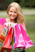 Woman with shopping bags — ストック写真