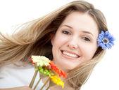 Donna con fiori — Foto Stock