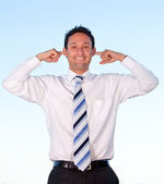 Business man covering his ears — Stock Photo