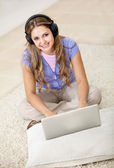 Woman downloading music — Stock Photo