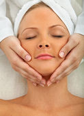 Woman having a face massage — Stock Photo