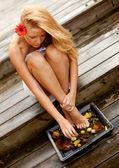 Beautiful woman washing her feet — Stock Photo