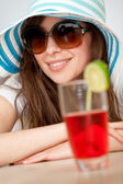Woman with a hat and a drink — Stock Photo