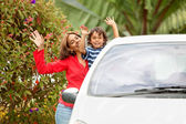 Mother and son with a car — Stock Photo