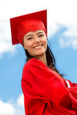 Graduated female in gown — Stock Photo