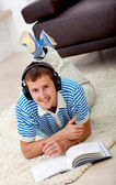 Man studying and listening to music — Stok fotoğraf