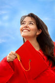 Female graduate throwing the mortarboard — Stock Photo