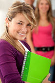 Girl with a notebook — Stock Photo