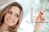 Business woman drawing a graph — Stock Photo