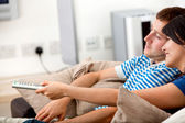 Loving couple watching tv — Stock Photo