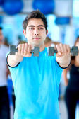 Man lifting weights — Stock Photo