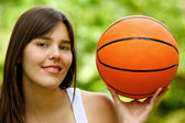 Woman with a basketball — Stock Photo