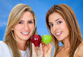 Women with apples isolated — Stock Photo