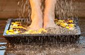 Woman moisting her feet — Stock Photo