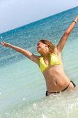 Woman splashing water — Stock Photo
