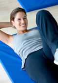 Woman doing abs — Stock Photo